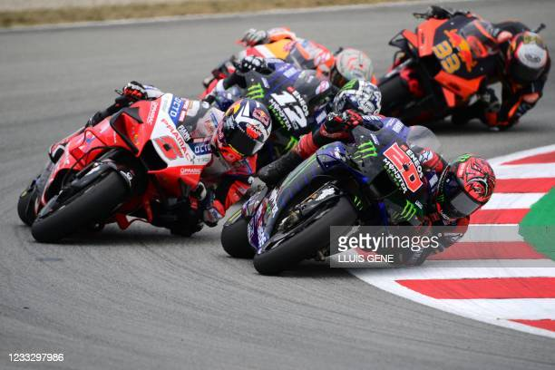 Yamaha French rider Fabio Quartararo rides ahead of Ducati-Pramac French rider Johann Zarco during the MotoGP race of the Moto Grand Prix de...