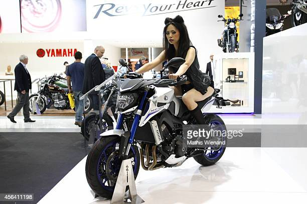 Yamaha girl presents Motorcycle in Yamaha booth during the International Motorcycle Scooter and EBike Fair at the Koelnmesse on September 30 2014 in...