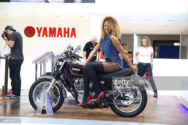 Yamaha girl with bike at the Yamaha booth during the 71st International Motorcycle Scooter and EBike Fair at the Koelnmesse on September 30 2014 in...