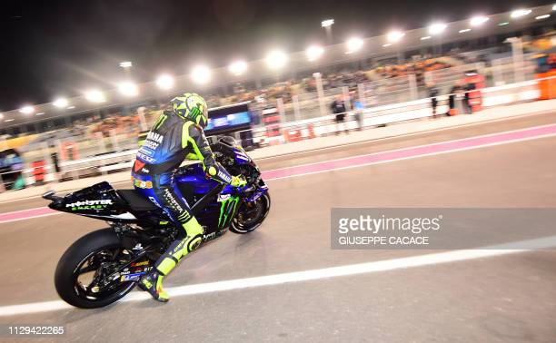 Yamaha MotoGP's Valentino Rossi of Italy leaves the pit during the fouth practice session at Losail track in Doha on March 9, 2019 ahead of the...