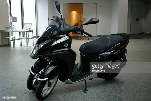 A Yamaha Motor Co Tricity threewheeled scooter with Leaning Multi Wheel mechanism stands on display at the company's showroom in Iwata Shizuoka...