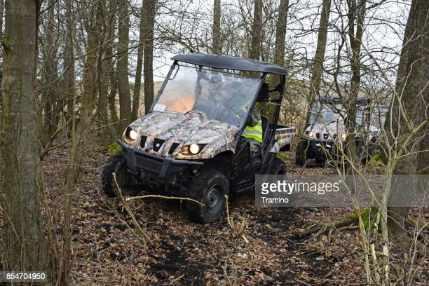 Yamaha Rhino 660 vehicles driving in the forest