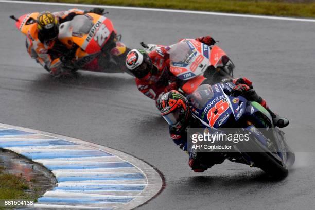 Yamaha rider Maverick Vinales of Spain leads Ducati rider Jorge Lorenzo of Spain and Honda rider Dani Pedrosa of Spain during the MotoGP Japanese...