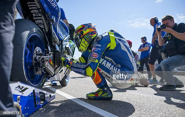 Yamaha rider Valentino Rossi of Italy prepares his bike in the pits prior to the third training session of the MotoGP Grand Prix of Germany at the...
