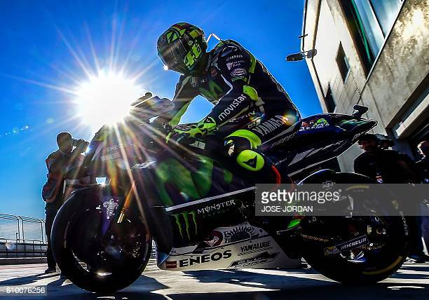 Yamaha Team's Italian rider Valentino Rossi leaves the pit during the Moto GP third practice session ahead of the Aragon Grand Prix at the Motorland...