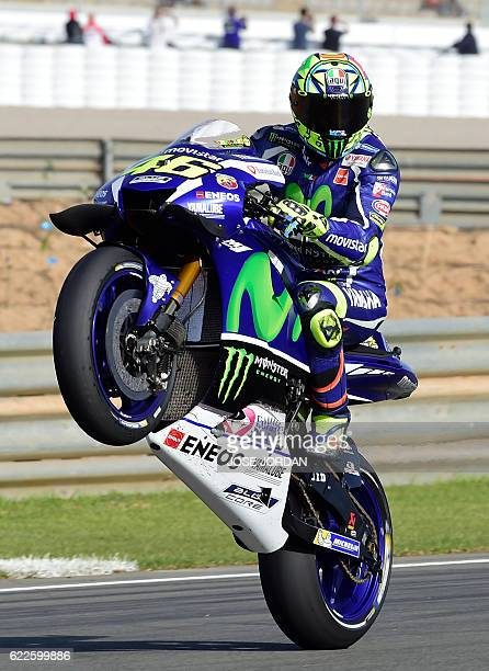 Yamaha Team's Italian rider Valentino Rossi pulls a wheelie during the Moto GP third Free practice session ahead of the Motul Comunidad Valenciana...