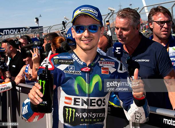 Yamaha Team's Spanish rider Jorge Lorenzo celebrates his third pole position after the Moto GP qualifying session on the eve of the Aragon Grand Prix...