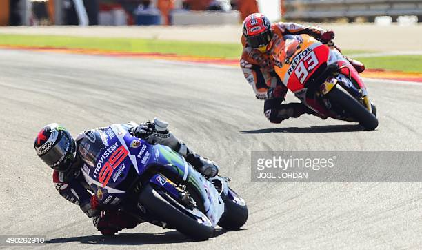 Yamaha Team´s Spanish rider Jorge Lorenzo competes with Repsol Honda's Spanish rider Marc Marquez during the Moto GP race of the Aragon Grand Prix at...