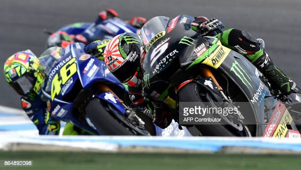 Yamaha Tech 3 rider Johann Zarco of France powers ahead of Yamaha rider Valentino Rossi of Italy during the Australian MotoGP Grand Prix at Phillip...