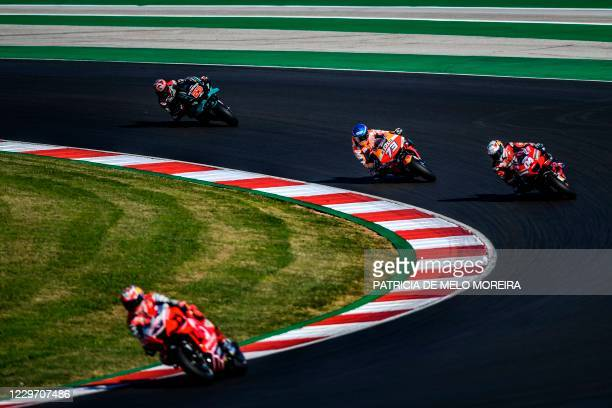 Yamaha's French rider Fabio Quartararo , Repsol Honda Team's Spanish rider Alex Marquez , Ducati's Italian rider Andrea Dovizioso and Pramac Racing's...