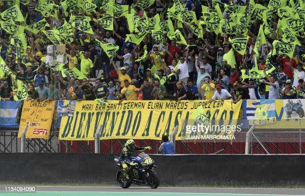 Yamaha's Italian biker Valentino Rossi waves at fans during the warmup of the MotoGP of the Argentina Grand Prix at the Termas de Rio Hondo circuit...