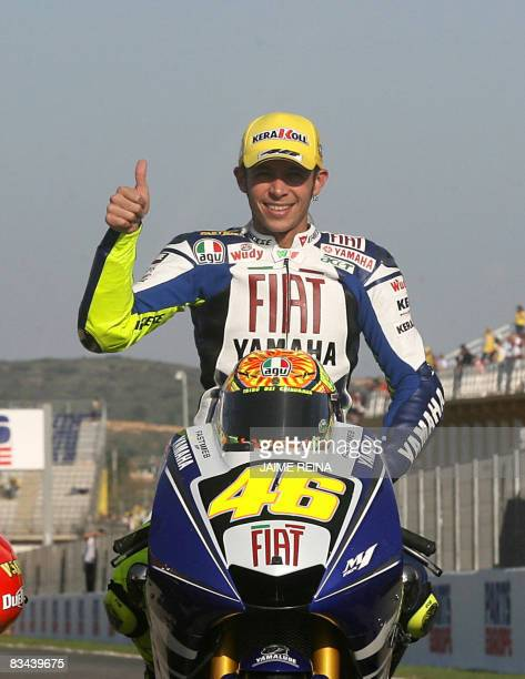 Yamaha's Italian driver Valentino Rossi poses as new world Moto GP champion after the Valencia Grand Prix at the Ricardo Tormo racetrack in Cheste...
