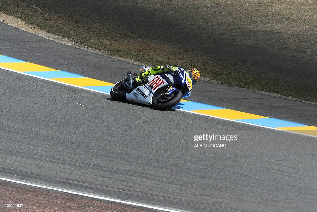 Yamaha's Italian rider Valentino Rossi takes a curve at Le Mans' circuit during a free practice session on May 21, 2010 two days ahead of the MotoGP French Grand Prix.