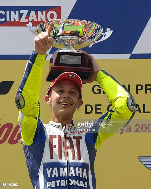 Yamaha's Italian Valentino Rossi celebrates on the podium of the Moto GP race of the Catalunya Grand Prix at the Montmelo racetrack on June 14, 2009...