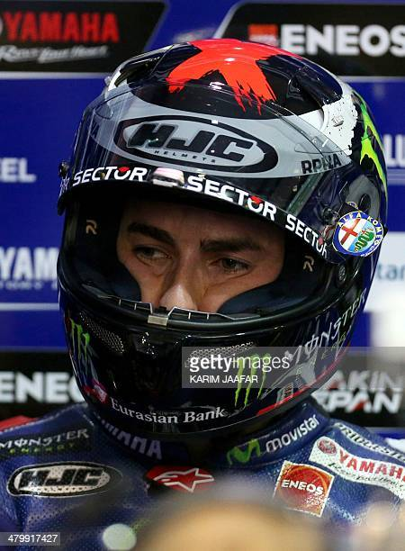 Yamaha's Jorge Lorenzo of Spain stands inside his team's garage after a free practice session of the MotoGP World Championship at the Losail...
