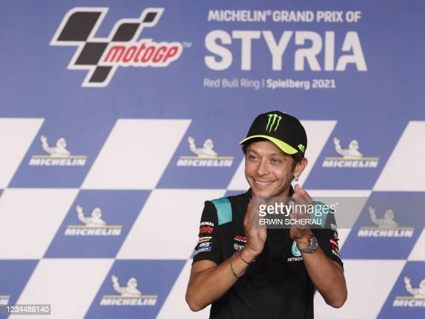 Yamaha-SRT Italian rider Valentino Rossi applauds at a press conference before announcing that he will retire at the end of the year, in Spielberg,...