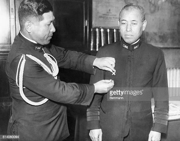 Yamamoto Isoroku Admiral and Commanderinchief of the Japanese Fleet receives a medal Yamamoto did not support the idea of war with the United States...