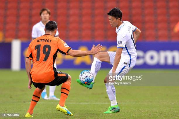 Yamamoto Shuto of the Antlers looks to take on the defence of Jack Hingert of the Roar during the AFC Asian Champions League Group Stage match...