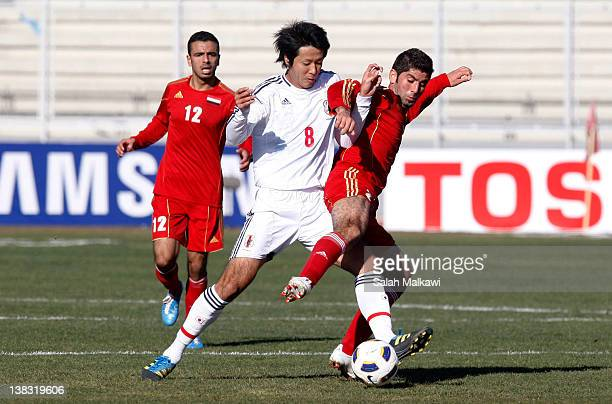 Yamamura Kazuya of Japan challenges Ahmad Al Salih of Syria during the Asian zone group C qualifying match for the London 2012 Olympics between Japan...