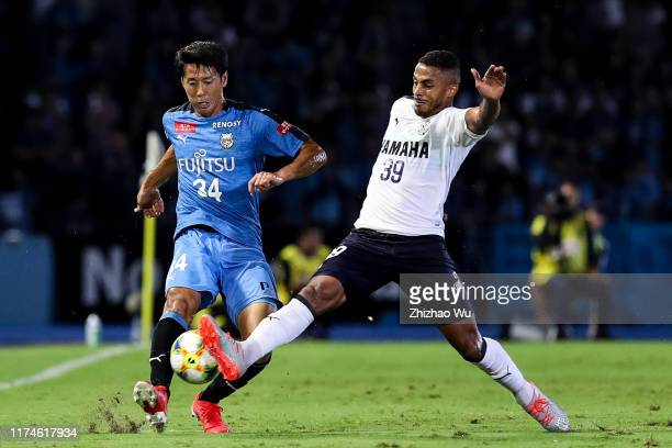 Yamamura Kazuya of Kawasaki Frontale competes for the ball with Lukian of Jubilo Iwata during the J.League J1 match between Kawasaki Frontale and...
