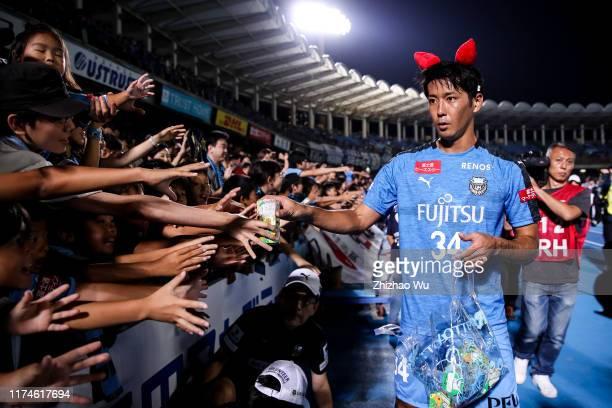 Yamamura Kazuya of Kawasaki Frontale gives the present to the children after the J.League J1 match between Kawasaki Frontale and Jubilo Iwata at...