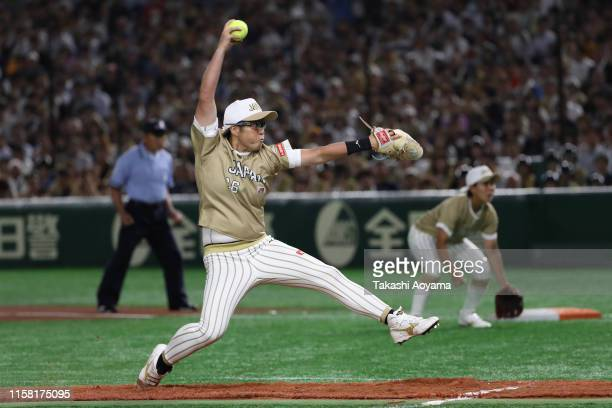 Yamato Fujita of Japan pitches against United States during the game three between Japan and United States at the Tokyo Dome on June 25 2019 in Tokyo...