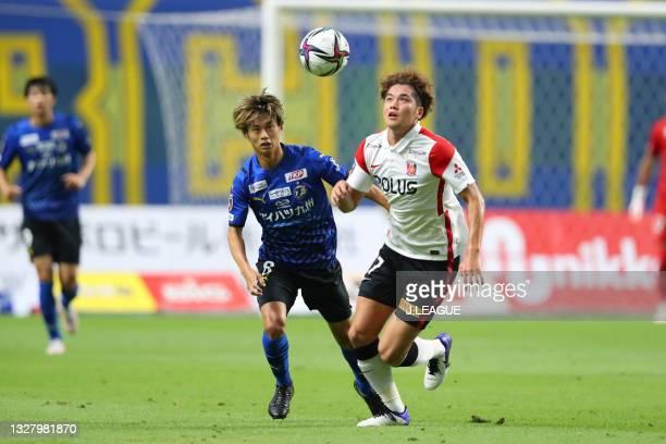 Yamato MACHIDA of Oita Trinita and Atsuki ITO of Urawa Reds battle for the ball during the J.League Meiji Yasuda J1 match between Oita Trinita and...