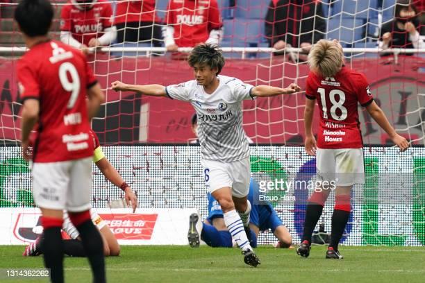 Yamato Machida of Oita Trinita celebrates scoring his side's second goal during the J.League Meiji Yasuda J1 match between Urawa Red Diamonds and...