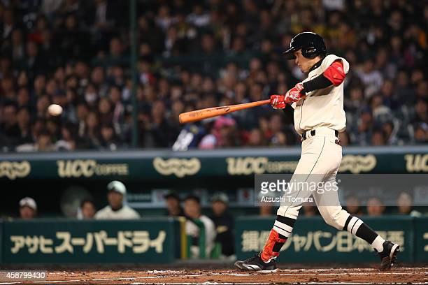 Yamato Maeda of Hanshin Tigers and Yomiuri Giants bats during the friendly match between Hanshin Tigers and Yomiuri Giants at the Hanshin Koshien...