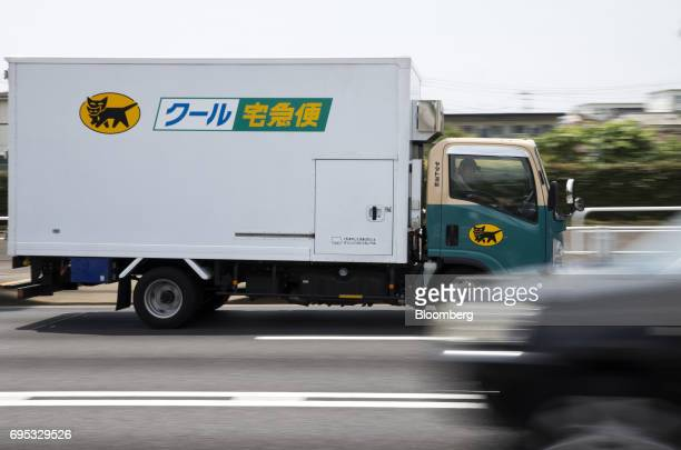 A Yamato Transport Co delivery truck drives along a street in Musashimurayama Tokyo Japan on Tuesday May 30 2017 In April Yamato announced that it...