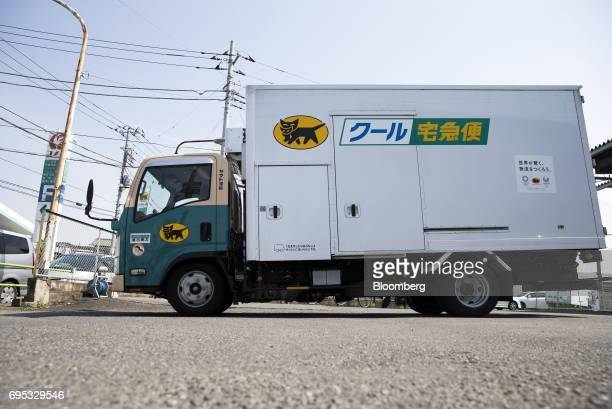 A Yamato Transport Co delivery truck leaves a Yamato branch in Musashimurayama Tokyo Japan on Tuesday May 30 2017 In April Yamato announced that it...
