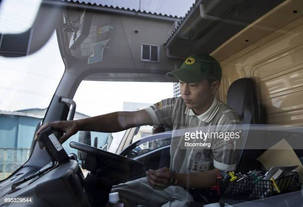 A Yamato Transport Co driver checks his delivery truck before departing a Yamato branch in Musashimurayama Tokyo Japan on Tuesday May 30 2017 In...