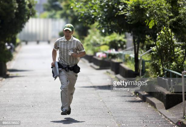 A Yamato Transport Co driver runs after delivering parcels to a residential building in Musashimurayama Tokyo Japan on Tuesday May 30 2017 In April...