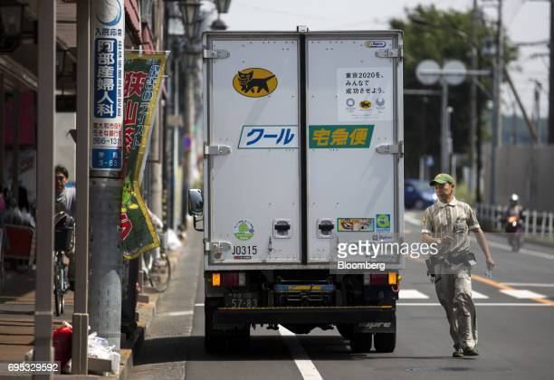 A Yamato Transport Co driver runs near a delivery truck in Musashimurayama Tokyo Japan on Tuesday May 30 2017 In April Yamato announced that it would...