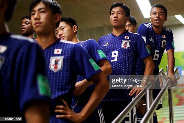 Yamato Wakatsuki of Japan and Joel Chima Fujita look on with teammates in the tunnel before the Group D Match between Japan and Netherlands in the...