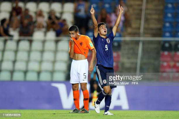 Yamato Wakatsuki of Japan celebrates in front of Anass Salah Eddine of Netherlands after scoring a goal during the Group D Match between Japan and...