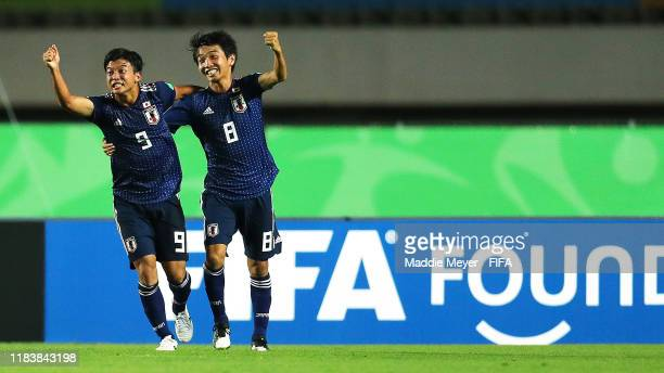 Yamato Wakatsuki of Japan celebrates with Hikaru Naruoka after scoring a goal during the Group D Match between Japan and Netherlands in the FIF U-17...