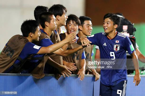 Yamato Wakatsuki of Japan celebrates with teammates after scoring a goal during the Group D Match between Japan and Netherlands in the FIF U17 World...
