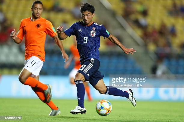 Yamato Wakatsuki of Japan dribbles past Devyne Rensch of Netherlands during the Group D Match between Japan and Netherlands in the FIF U17 World Cup...