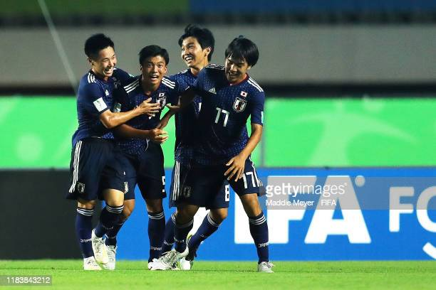 Yamato Wakatsuki of Japan second from left celebrates with teammates after scoring a goal during the Group D Match between Japan and Netherlands in...