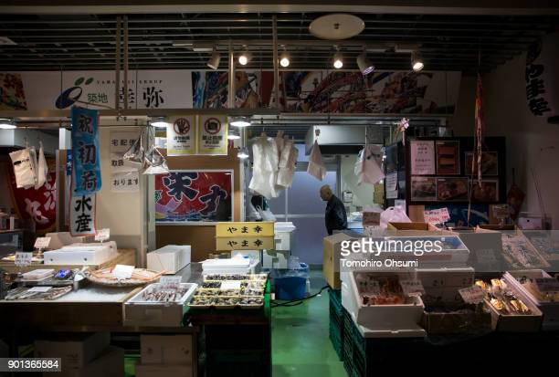 Yamayuki Group employee waits for the arrival of the highest priced fresh bluefin tuna auctioned from the year's first auction at Tsukiji Market on...