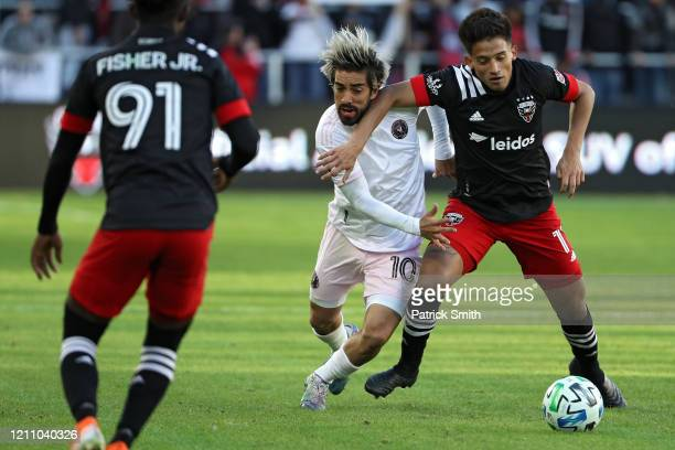 Yamil Asad of D.C. United and Rodolfo Pizarro of Inter Miami battle for the ball during the second half at Audi Field on March 7, 2020 in Washington,...