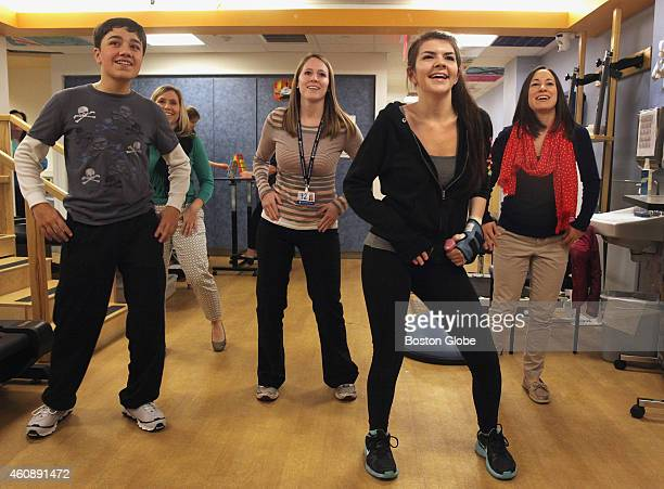 Yamil Ortiz of Puerto Rico physical therapy student Jessica Gugger Alexandra Reusch of Woburn Mass and occupational therapist Jenna Duckworth do...