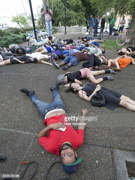 Yamil Rodriguez foreground leads 50 people in a diein at the New Orleans Police Department in New Orleans Louisiana on July 8 2016 According to the...