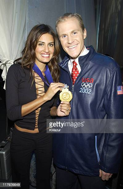 Yamila DiazRahi Sports Illustrated's Swimsuit 2002 Cover Supermodel and Casey FitzRandolph pose with Casey's gold medal for 500meter speedskating in...