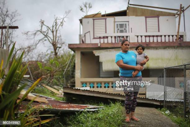 Yamiles Vazquez poses with her baby Joy on a section of her family's damaged property three weeks after Hurricane Maria hit the island on October 11...