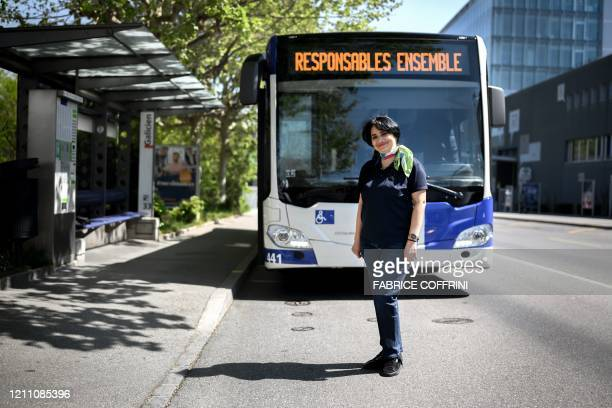 Yamileth Parra bus driver of Lausanne's public transport system poses for a picture in Lausanne on April 22 2020 as Switzerland remains in lockdown...