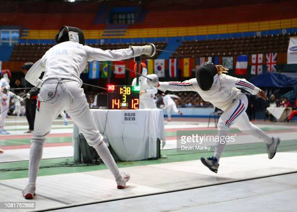 Yamilka Rodriguez Quesada of Cuba fences Alexandra Louis Marie of France during the elimination rounds at the Women's Epee World Cup on January 12...