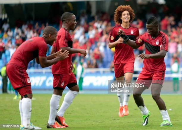 Yamilson Rivera of America de Cali and his teammates celebrate a scored goal against Universitario de Popayan during a match between America de Cali...