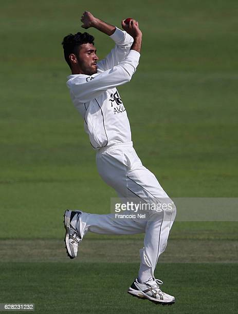 Yamin Ahmadzai of Afghanistan bowls during day one of the tour match between England Lions and Afghanistan at Zayed Cricket Stadium on December 7...